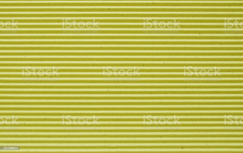 yellow corrugated paper background. stock photo