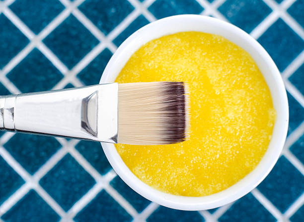 Yellow cosmetic mask (scrub) in a bowl stock photo