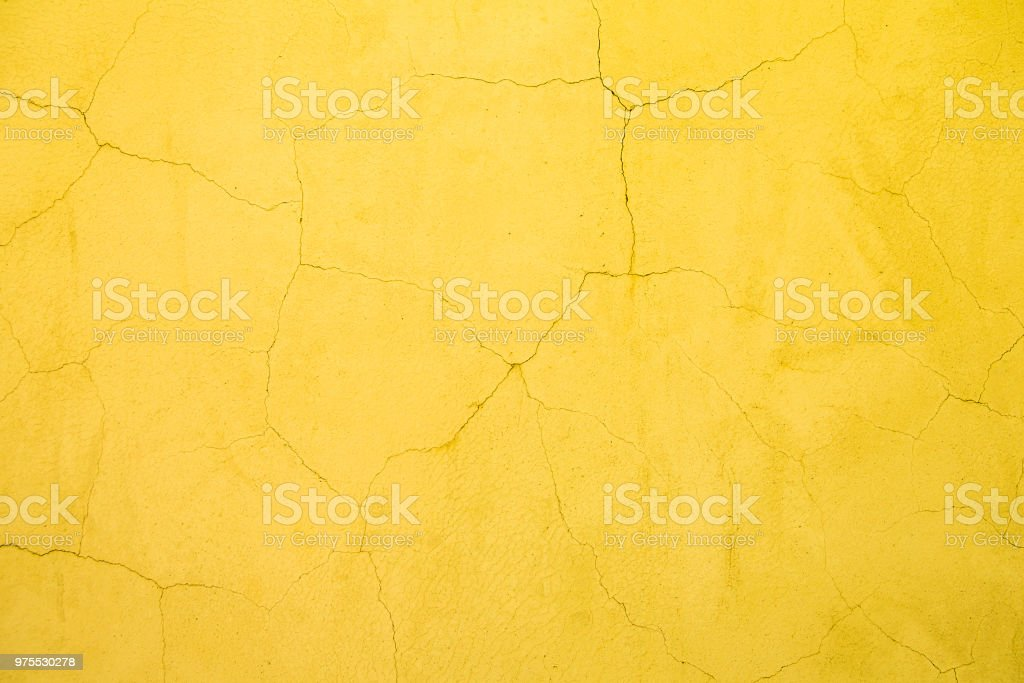 yellow crack wall background texture stock photo