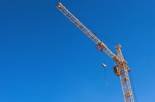 yellow crane and blue sky