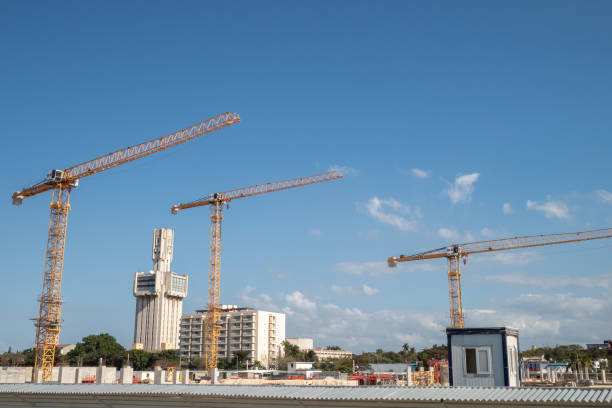 Yellow cranes on a building site in Havana, Cuba stock photo