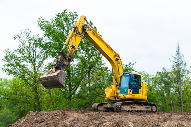 Yellow crawler excavator with operator cab on construction site. Backhoe loader. stock photo
