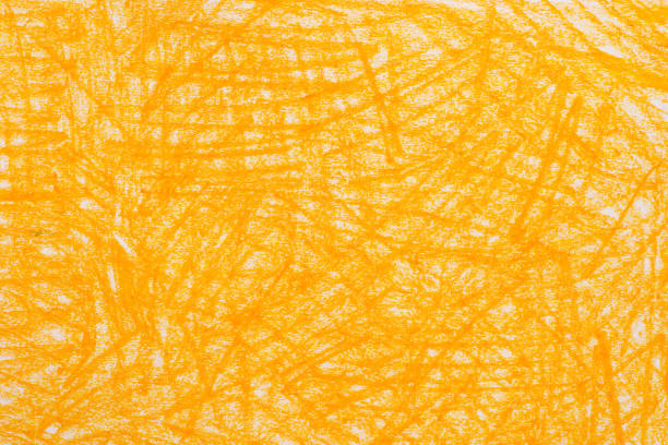 yellow crayon doodles background texture stock photo