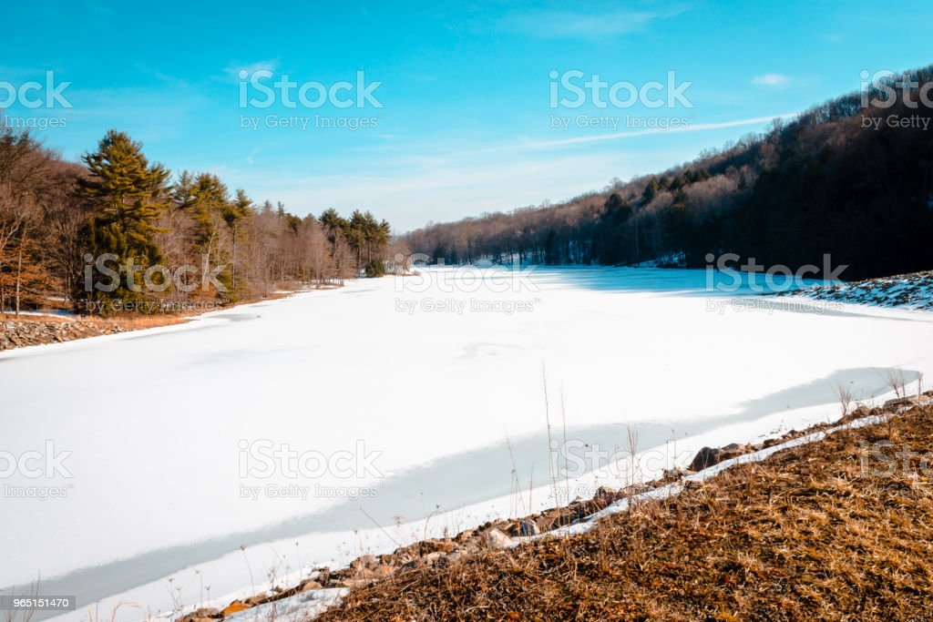 Yellow Creek lake frozen over during the winter time royalty-free stock photo