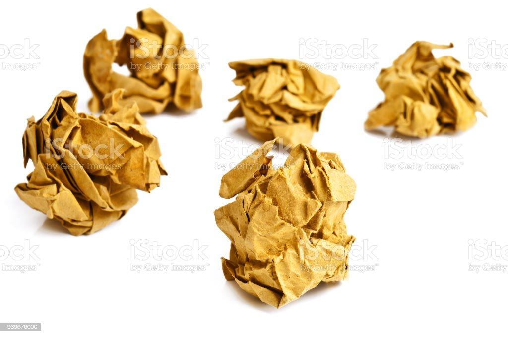 yellow crumpled paper balls on white stock photo