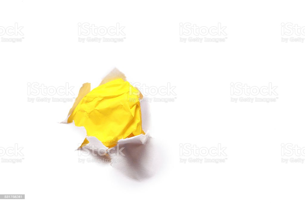 Yellow Crumpled Paper In Torn Hole stock photo