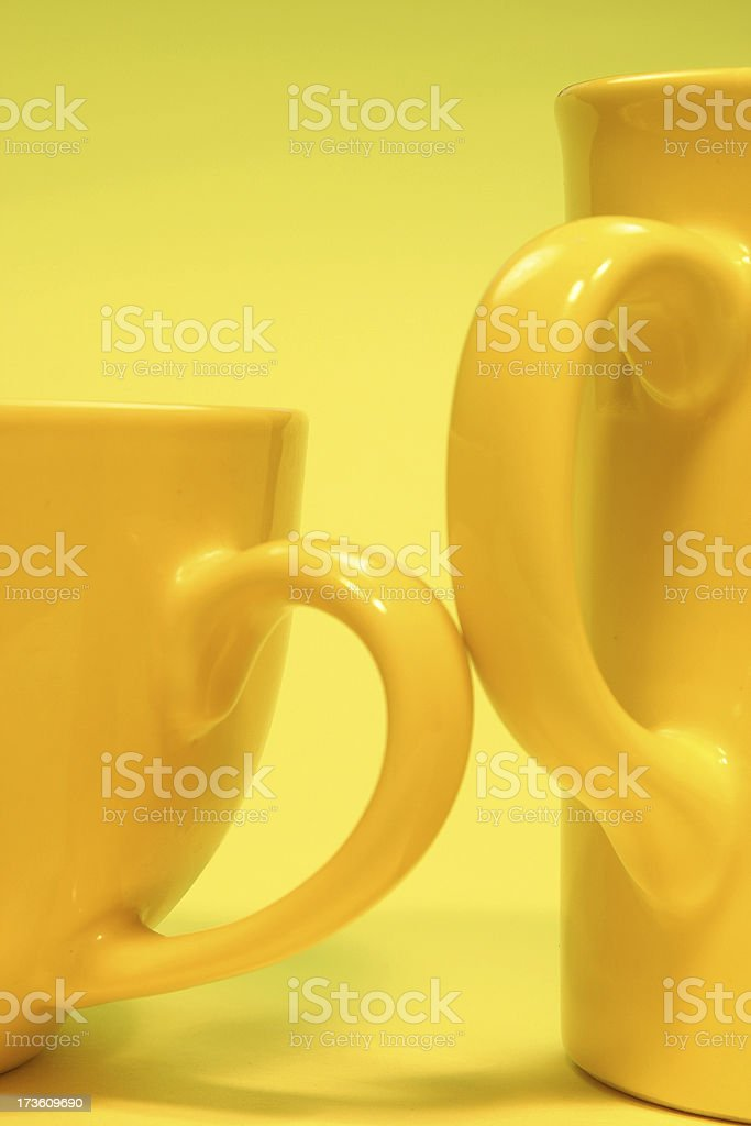 yellow cup together royalty-free stock photo