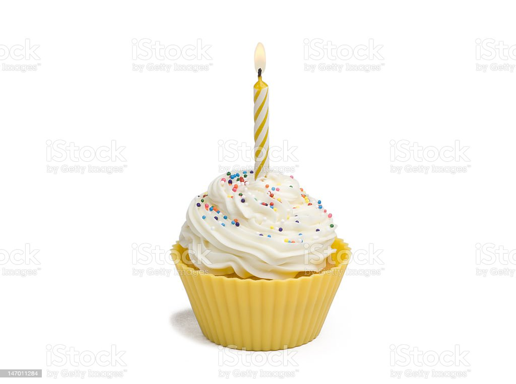 Yellow cupcake and candle royalty-free stock photo