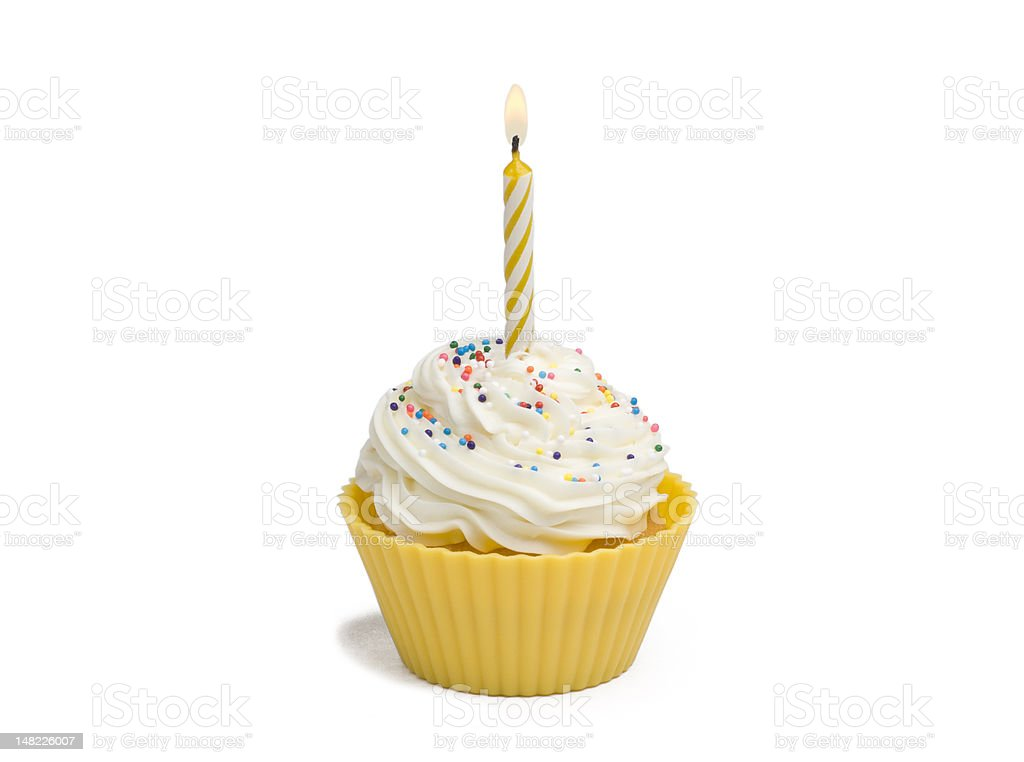 Yellow cupcake and candle stock photo