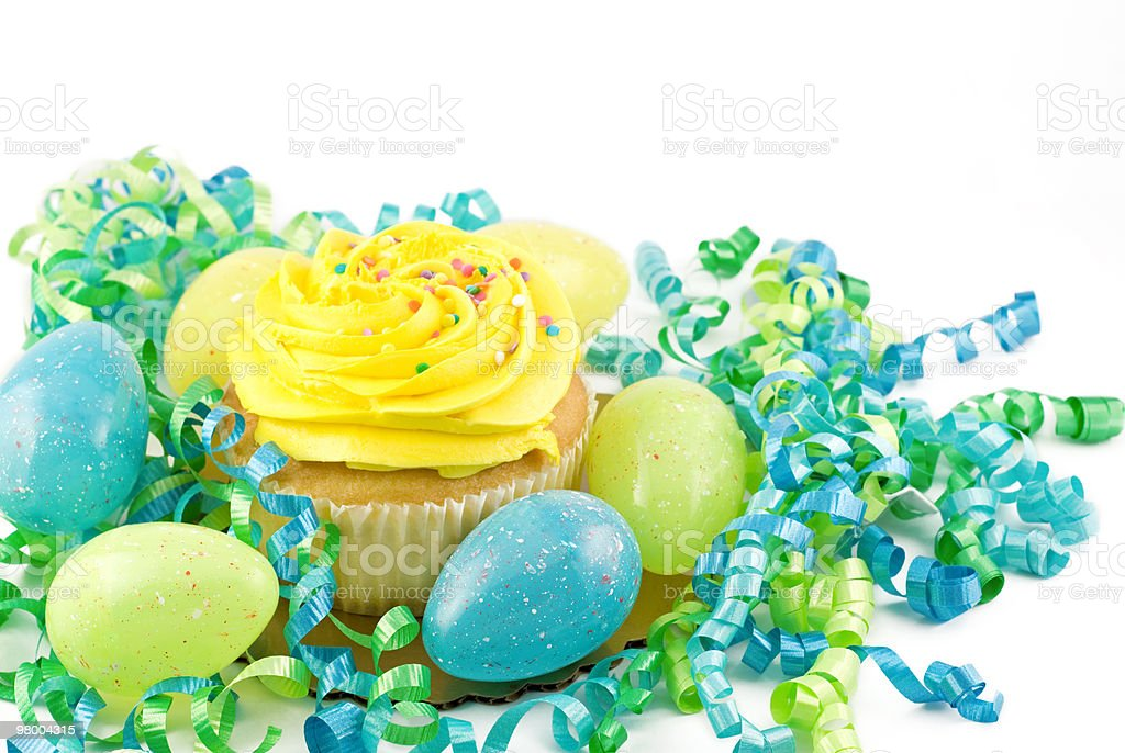 Yellow Cupcake with Easter Eggs and decorations royalty-free stock photo