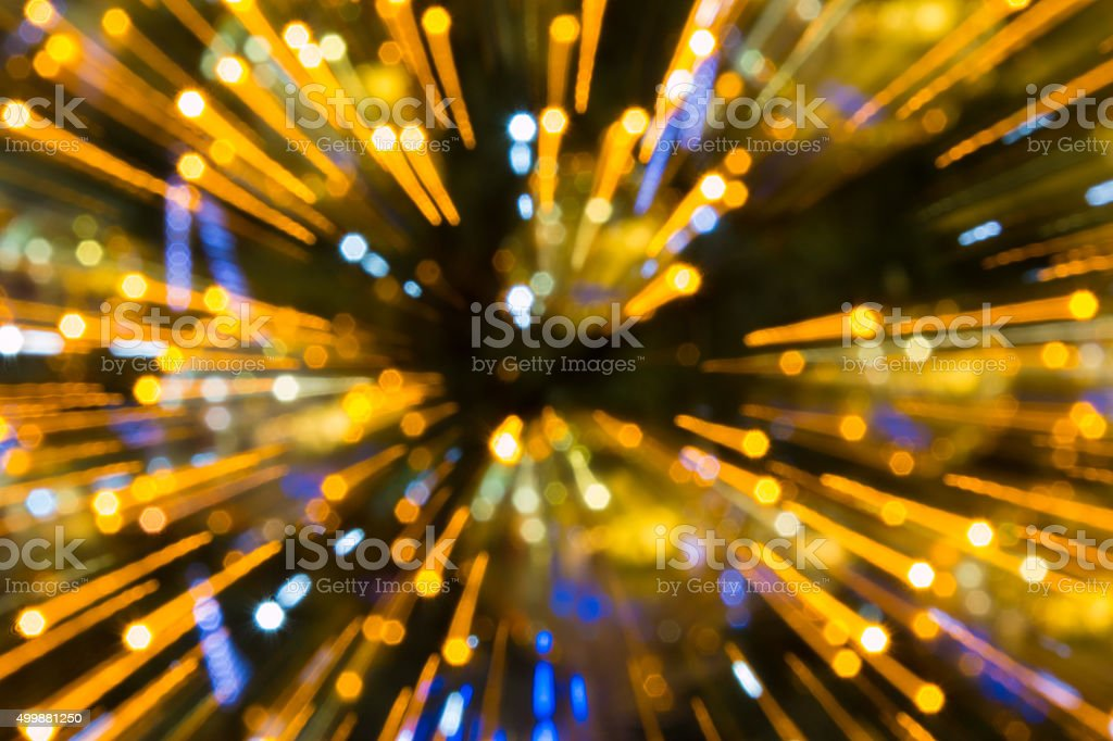 yellow, dark, red background with christmas lights in boken. Bokeh stock photo