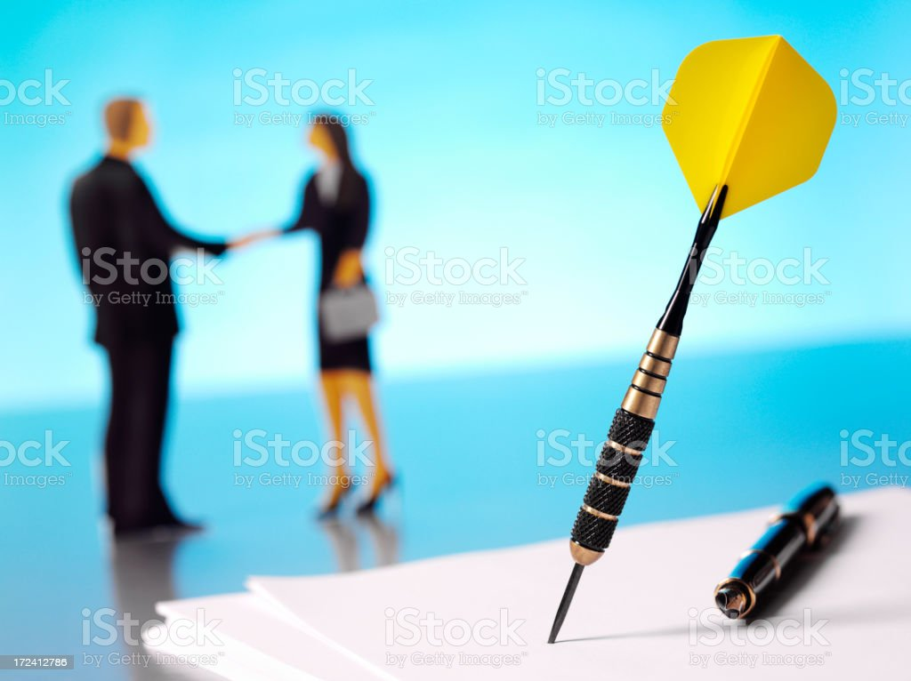 Yellow Dart with a Businessman and Women Shaking Hands royalty-free stock photo