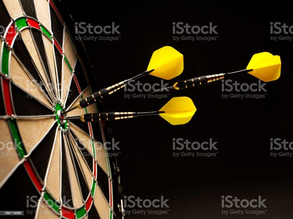 Yellow Darts in a Dartboard royalty-free stock photo