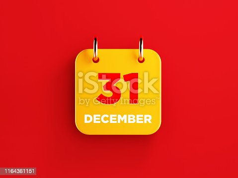 istock Yellow December 31 Calendar on Red Background 1164361151