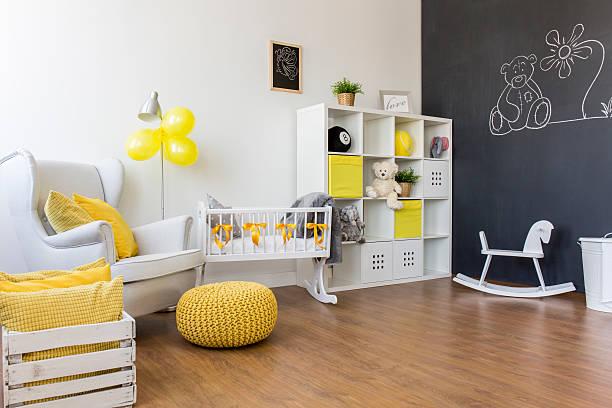 yellow decorations in baby room - tafel schlafzimmer stock-fotos und bilder