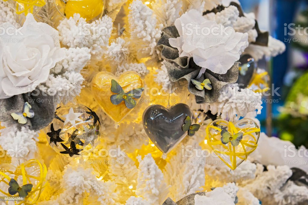 yellow decorations on a christmas tree flowers hearts butterflies snow royalty