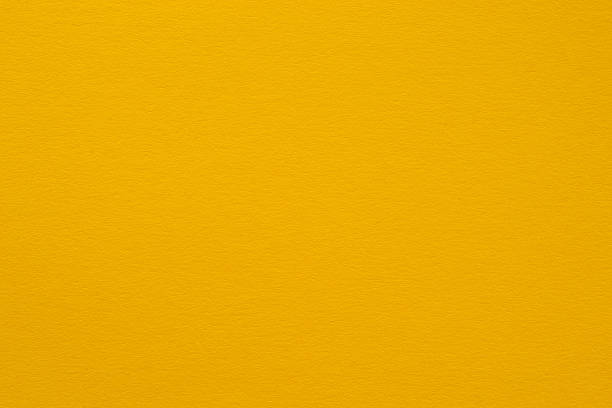 Yellow decorative paper close-up stock photo