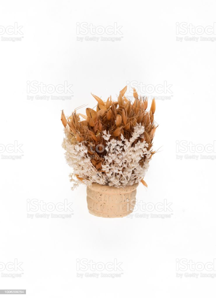 Yellow Decorative Vase With Yellow Artificial Flowers On A White