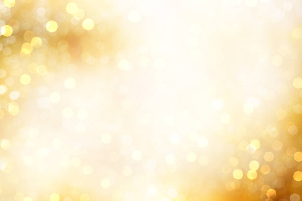 yellow defocused light background for christmas - goldener glitzer stock-fotos und bilder