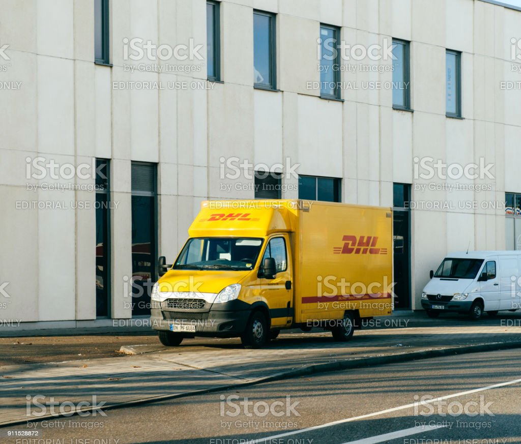 DHL yellow delivery van on German street stock photo