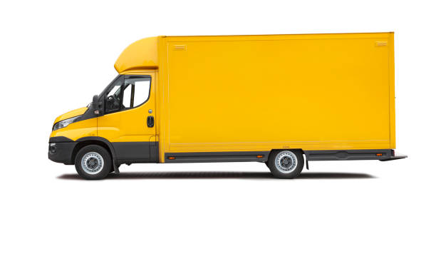 Yellow delivery van on white background stock photo