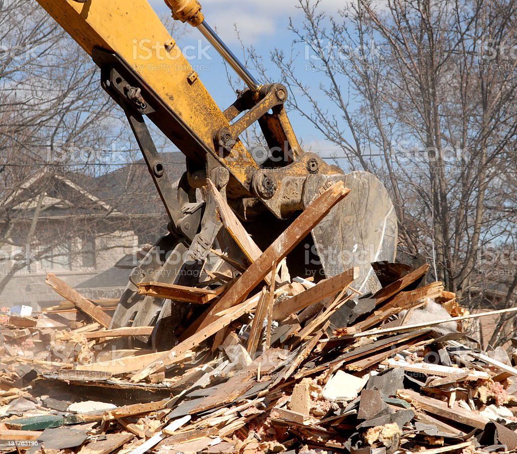 Yellow demolition excavator working at job site stock photo