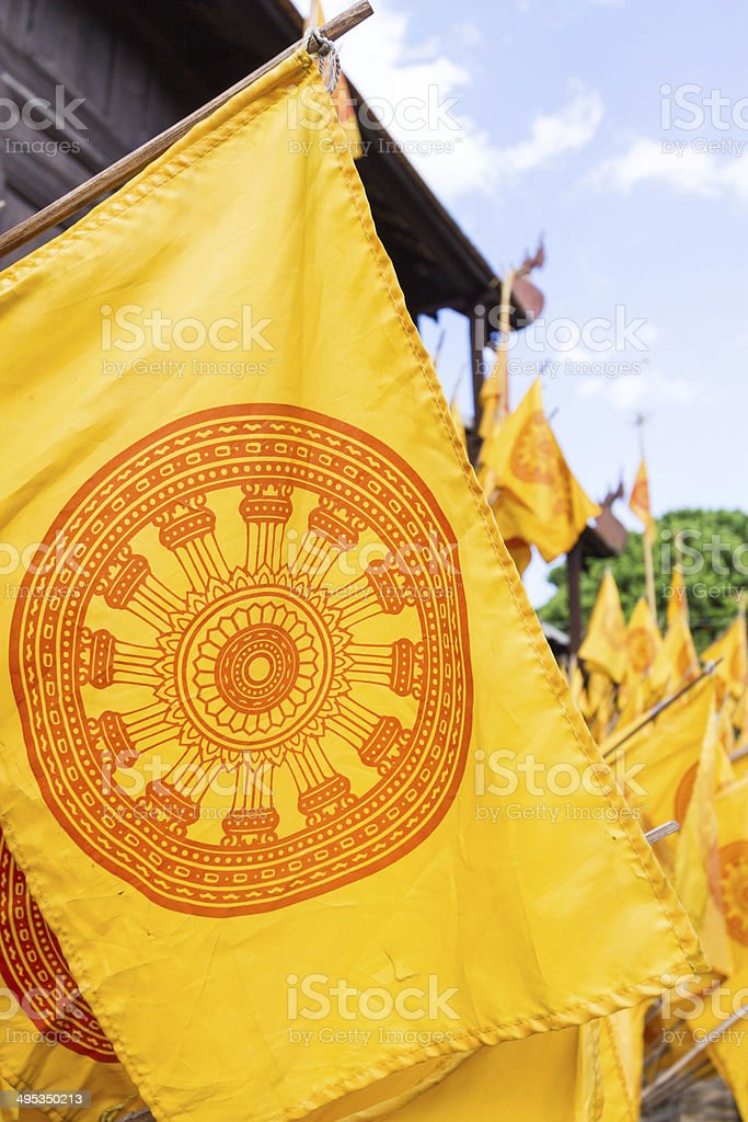 yellow dharmachakra flag stock photo
