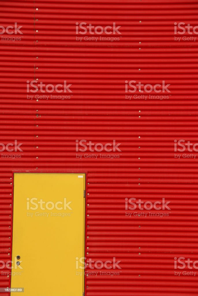 Yellow Door in Red Building royalty-free stock photo