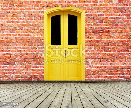 Wood door on the brick wall retro entrance