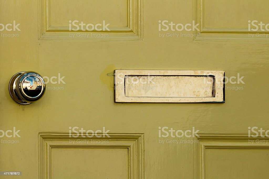 Yellow Door With Bronze Handle And Mail Drop Box Royalty Free Stock Photo