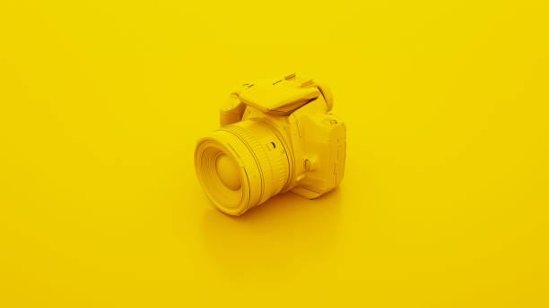 Yellow DSLR Camera. 3D illustration Yellow DSLR Camera. 3D illustration. toned image stock pictures, royalty-free photos & images