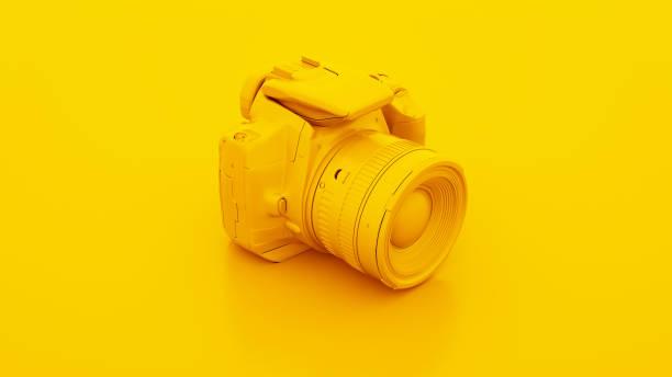reflex numérique jaune. illustration 3d - fond couleur uni photos et images de collection