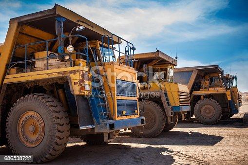istock Yellow dump trucks 686538722