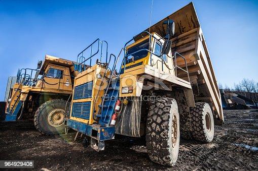 istock Yellow dump trucks 964929408