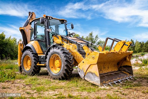 Yellow earth mover in construction site