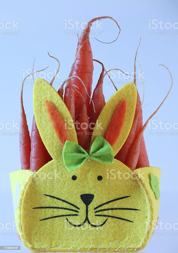 Yellow easter bunny filled with carrots royalty-free stock photo