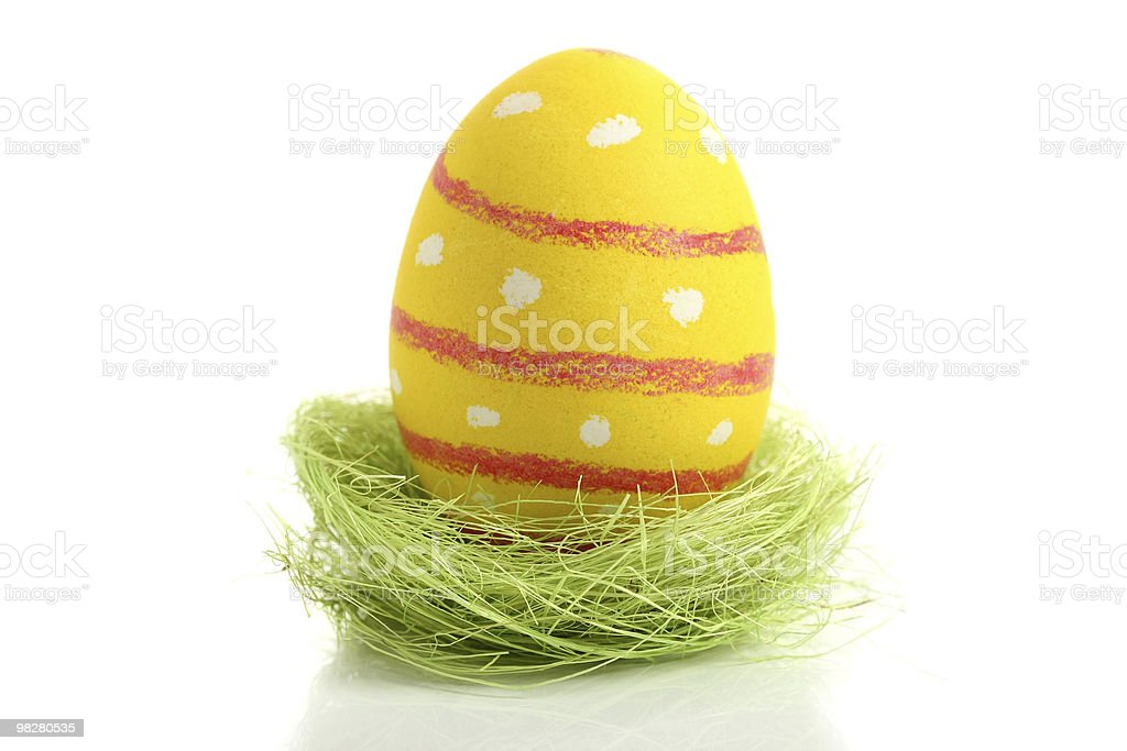 Yellow easter egg in nest royalty-free stock photo