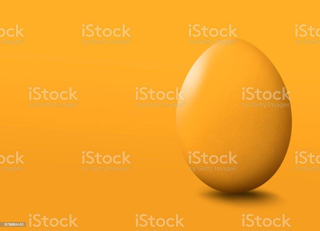 Yellow easter egg on yellow background. stock photo