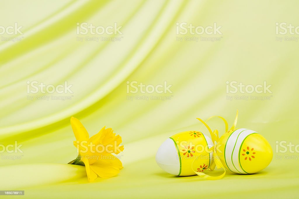 Yellow Easter Eggs and Daffodils Bloom royalty-free stock photo