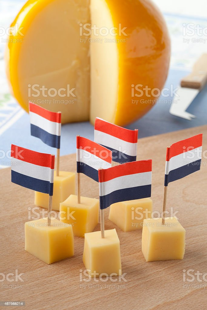 Yellow Edam cheese blocks with Dutch flags stock photo