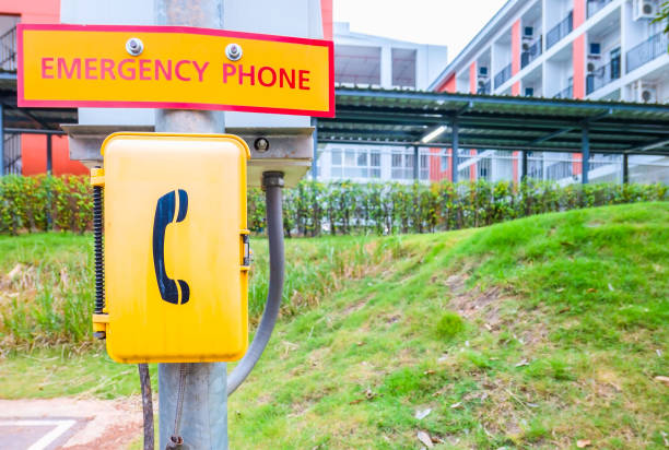 a yellow emergency phone box outdoor in the park - call center стоковые фото и изображения