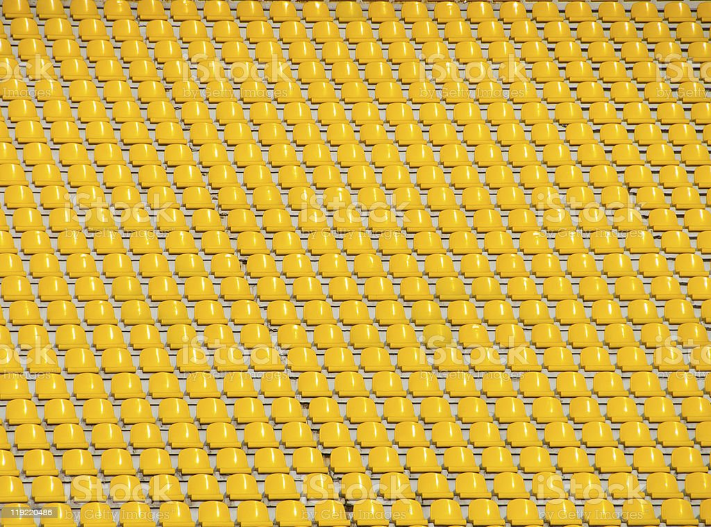Yellow empty stadium seats royalty-free stock photo