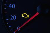 istock yellow engine check engine icon on car dashboard, black background 1181260178