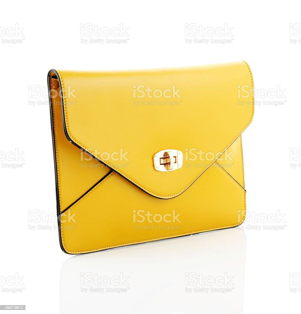 Yellow envelope style handbag isolated on white background stock photo