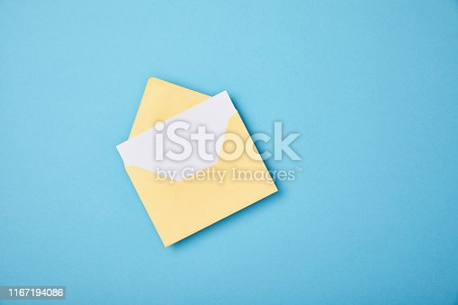 yellow envelope with blank white card on blue background
