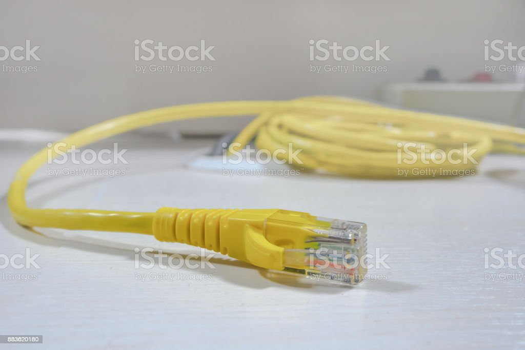 Yellow ethernet cable connector stock photo