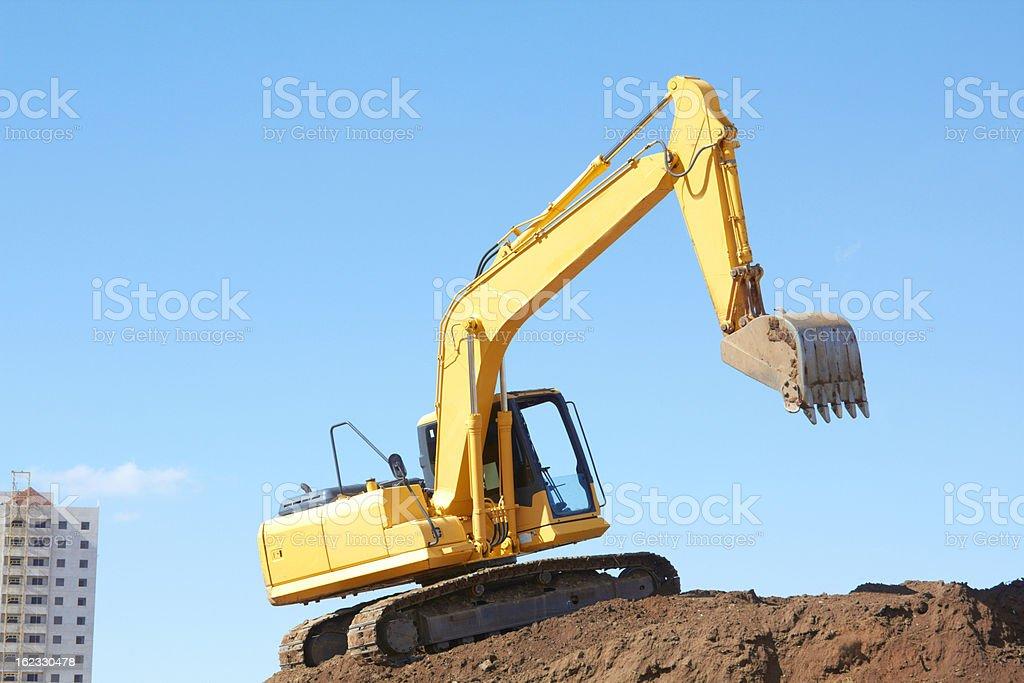 Yellow Excavation Machine On Heap Of Soil royalty-free stock photo