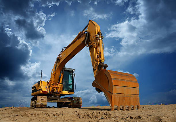 Yellow Excavator at Construction Site  construction machinery stock pictures, royalty-free photos & images