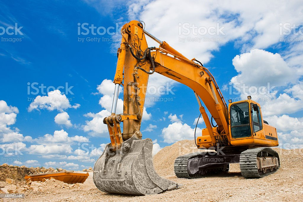 Yellow Excavator at Construction Site stock photo