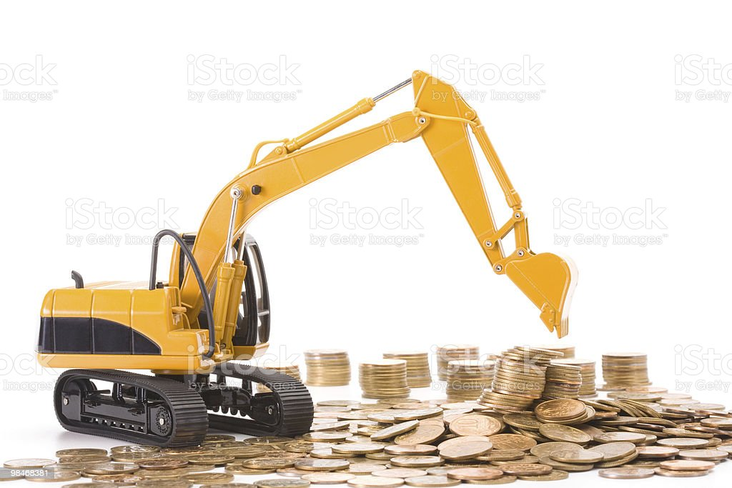 Yellow excavator digging a heap of coins royalty-free stock photo